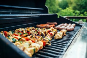 BBQ Grill with skewers and sausage