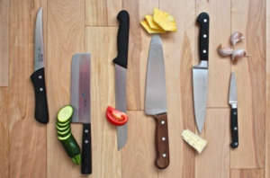Kitchen knives with fruits and vegetables