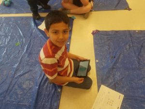 Child participating in coding lesson
