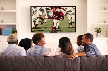 People watching football game on tv
