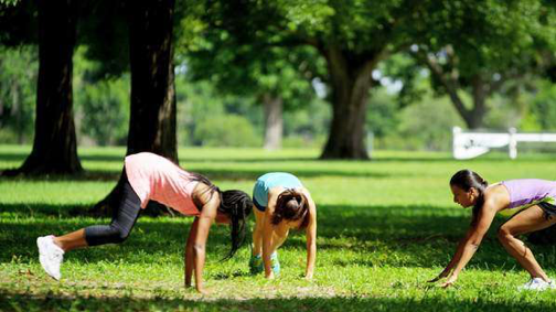 Women working out on a lawn