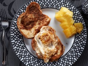 Breakfast plate with egg on toast and pineapple