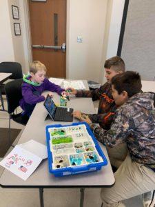 Kids building LEGO robots