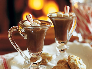 mugs of hot chocolate with marshmallows and peppermint