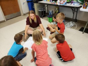4H teen leader teaching younger children