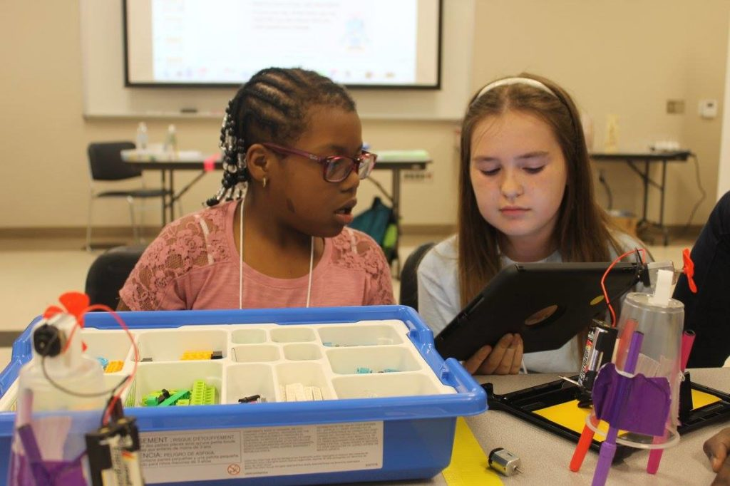 Two girls working on coding project
