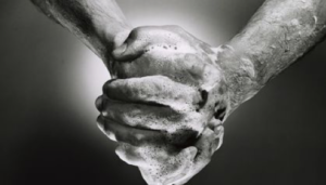 black and white photo of hands with soapy water