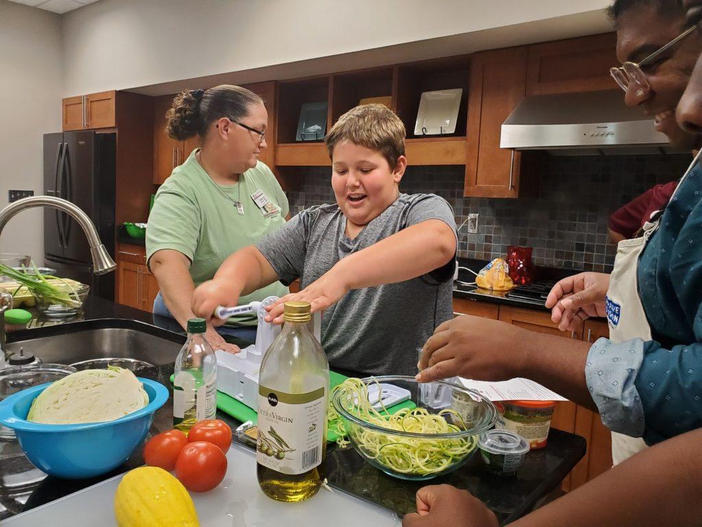 4H camper making zucchini noodles