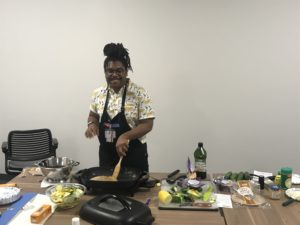 FCS Agent Marcus McFarland cooking for National Nutrition Month Event