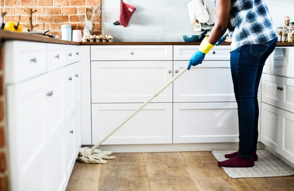 A Person Mopping the floor and housekeeping