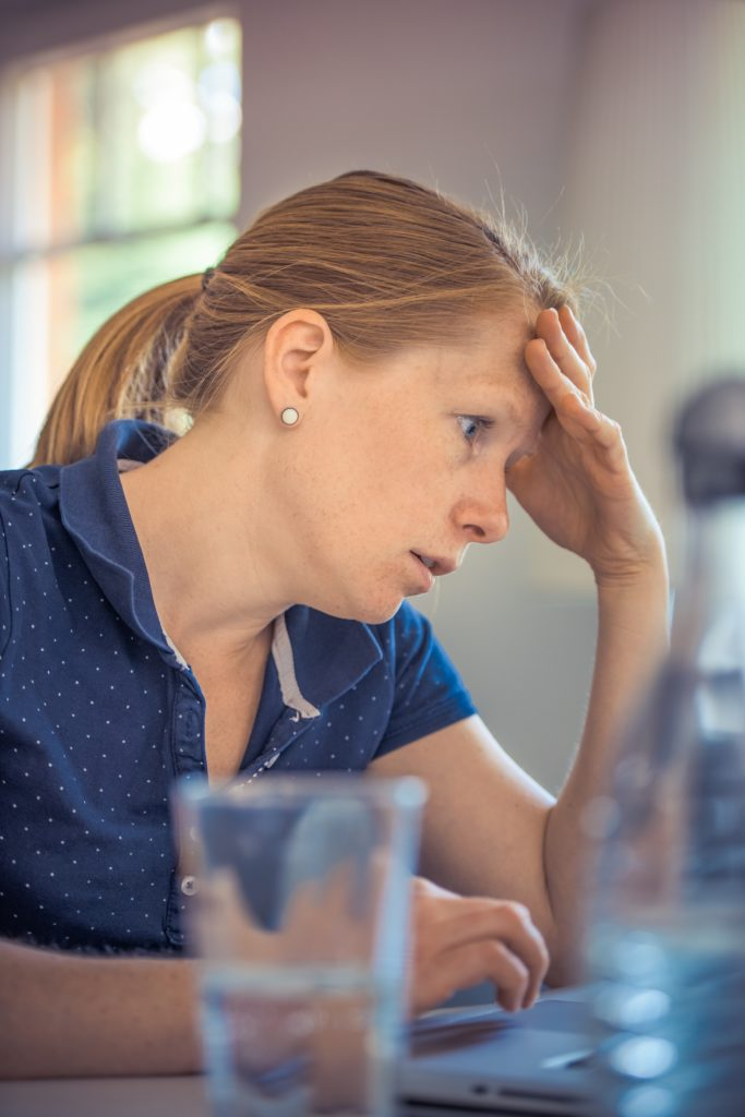 Woman working at computer who appears stressed