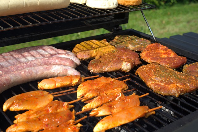 chicken steak and sausage on the grill