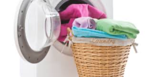 laundry basket with clothes folded in it