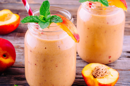 peach smoothie in mason jar