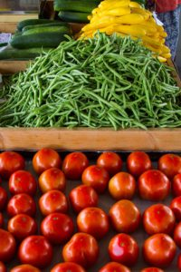Tomatoes, squash and green beans on table at farmers market