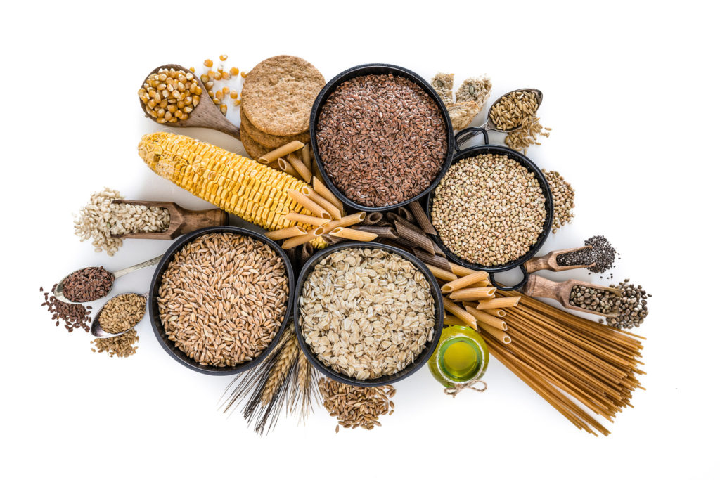 a variety of whole grains and corn