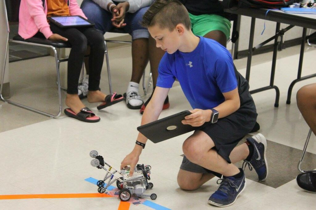 Child Works with Robotics Toy Made