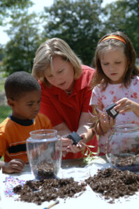 A horticultural agent works with students to make terrariums...Becky Kirkland photos..