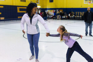 Union County 4-H Summer Intern, Angel, playing with a child in the 4-H program in a gymnasium