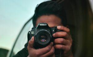 Man holding a black camera