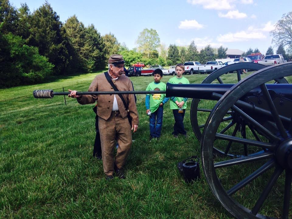 Man Loading Cannon