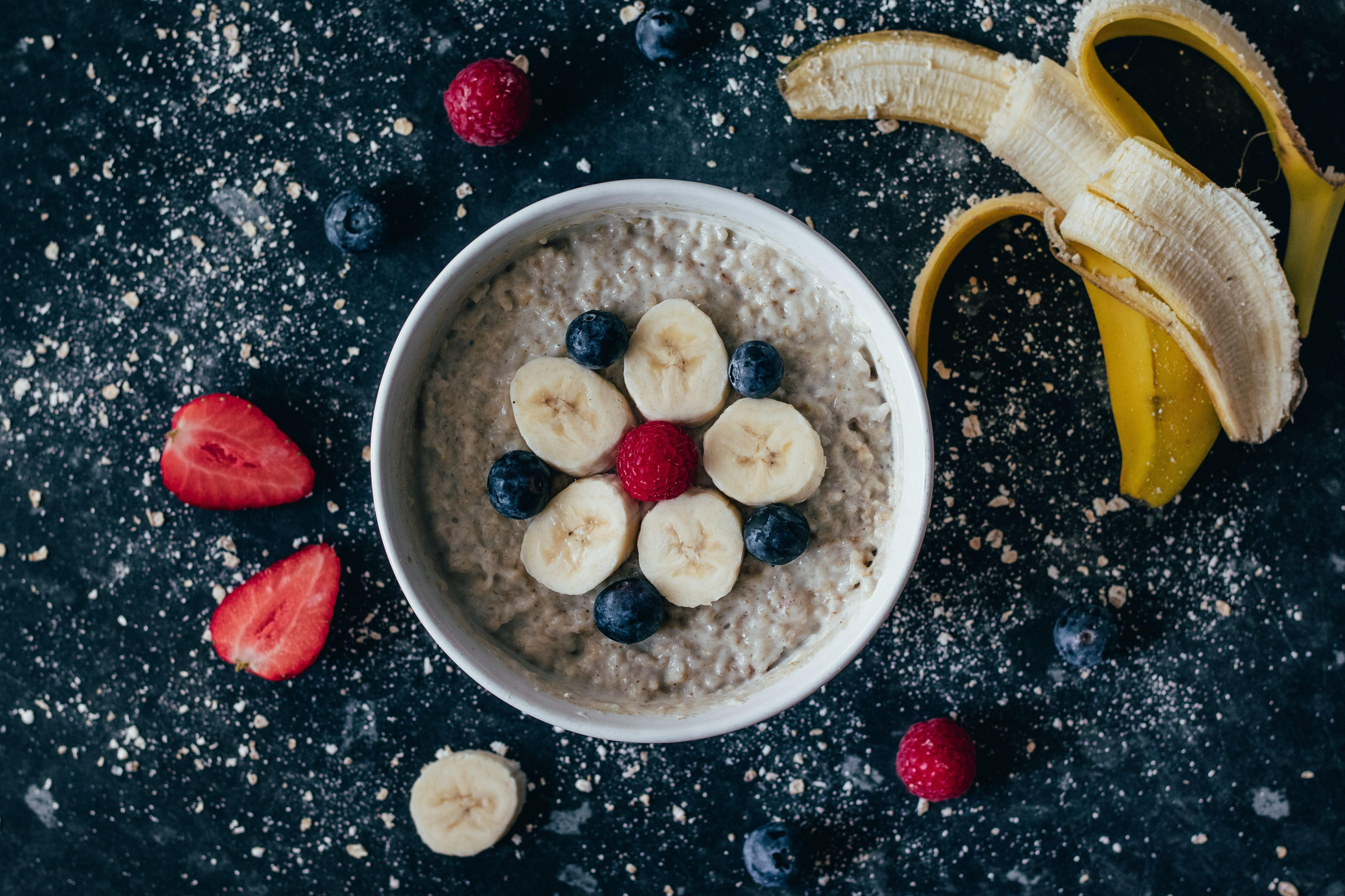 Bowl of Oatmeal with Bananas Blueberries and Raspberries